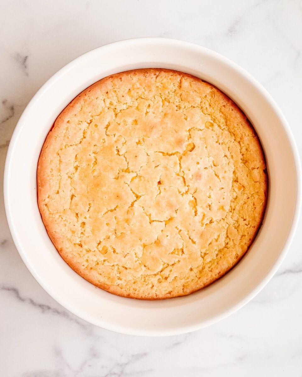 whole gluten free corn casserole in white ceramic dish