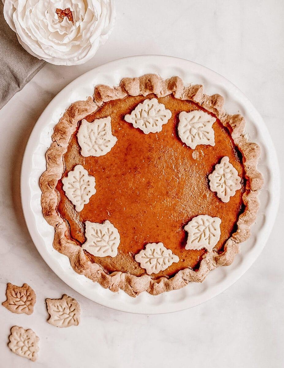 gluten free pumpkin pie aerial view in white ceramic pie dish