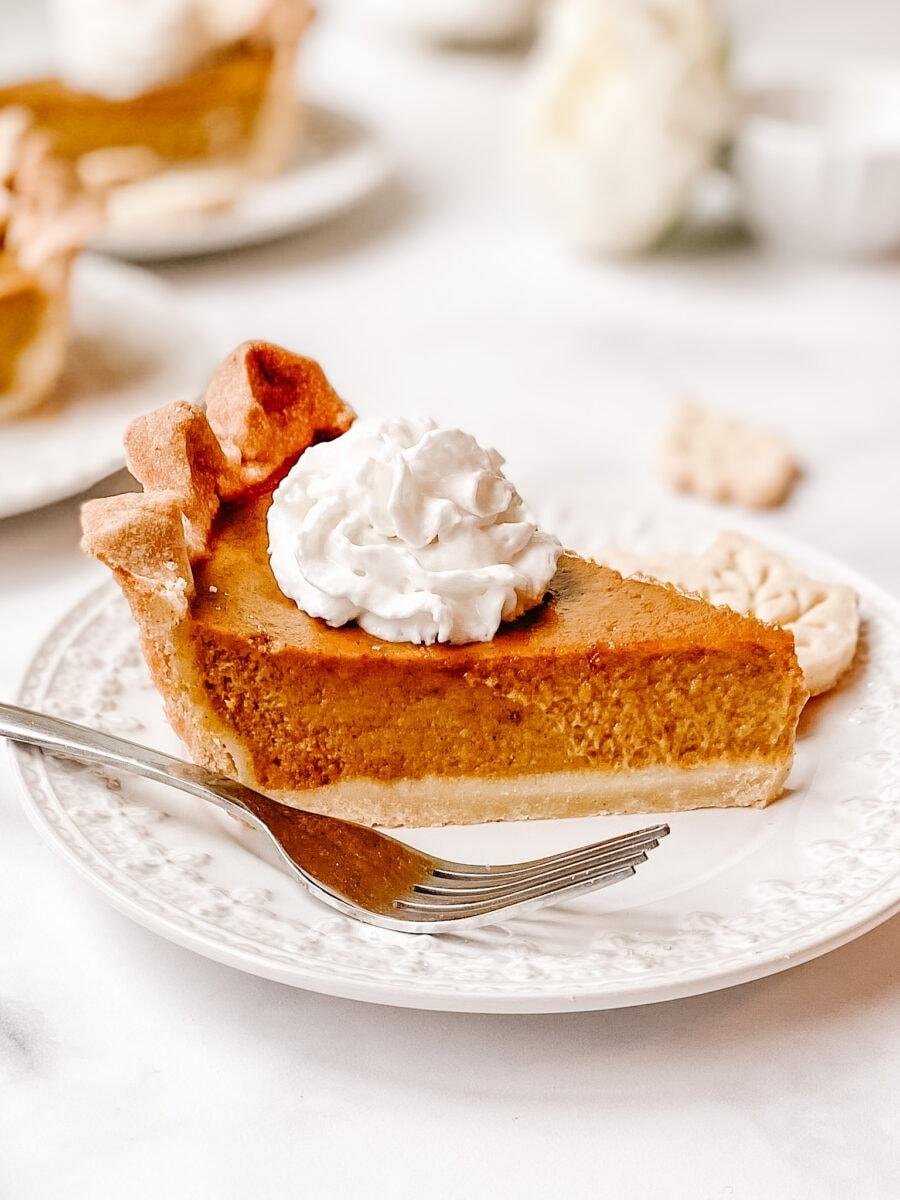gluten free pumpkin pie slice with whipped cream