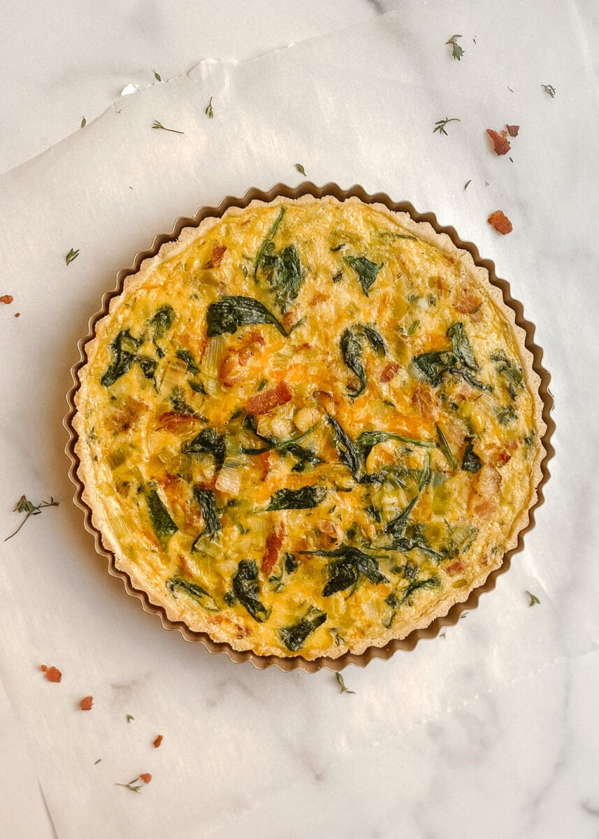 gluten-free bacon, leek, and spinach quiche photo shot from above