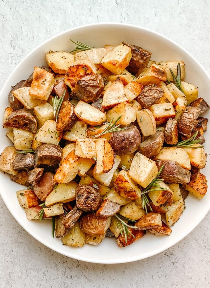 closeup of multi colored potatoes in a white bowl