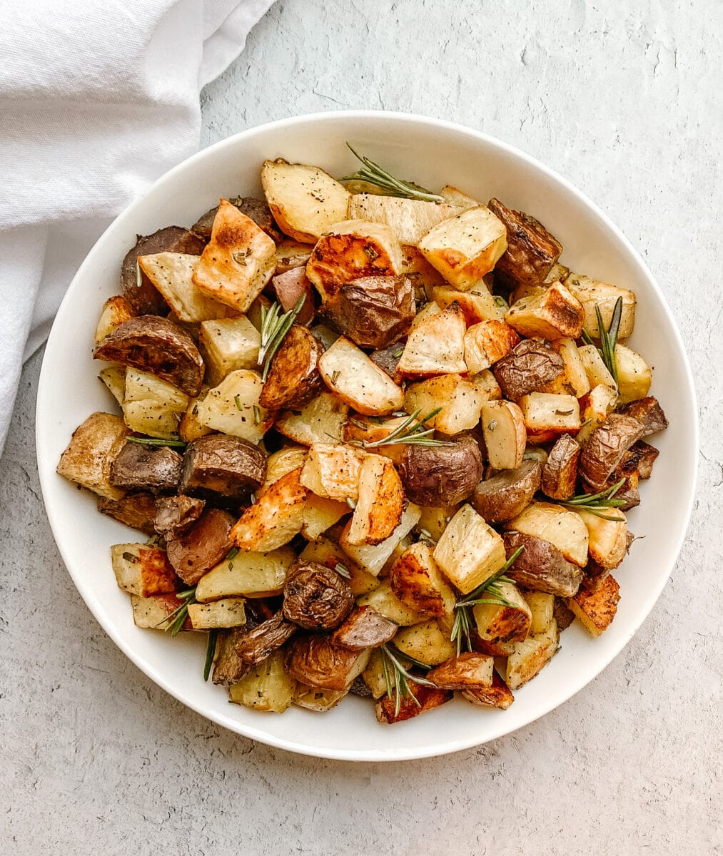 aerial shot of potatoes in a bowl with a white napkin on the outside