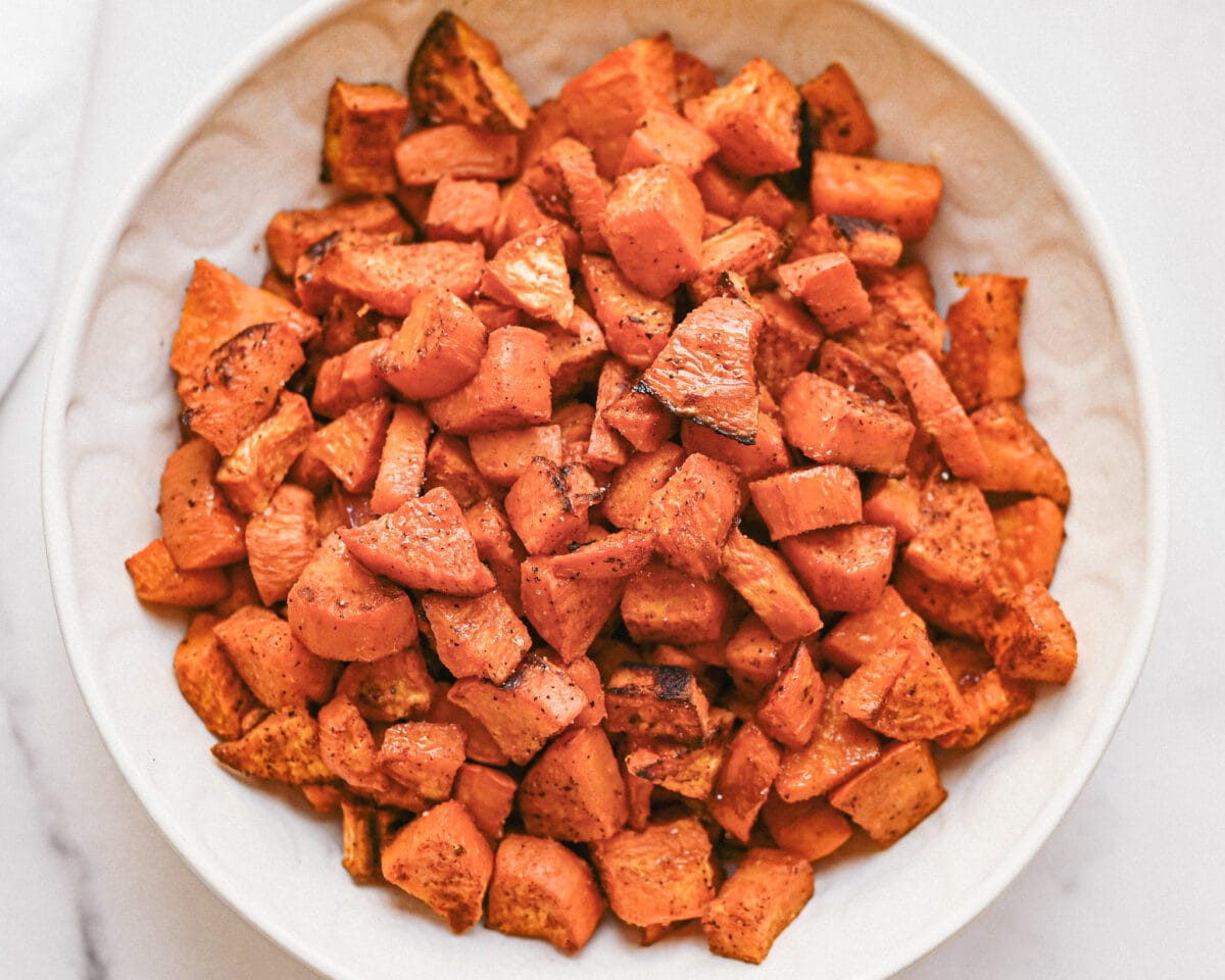 roasted sweet potatoes fully cooked in a white bowl